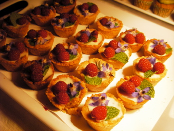 Vegan Coconut Lime Tarts with Toasted Cashew Crust. Raspberries and Edible Flowers